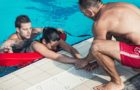 Lifeguards in training - Rescuing victim from public swimming pool